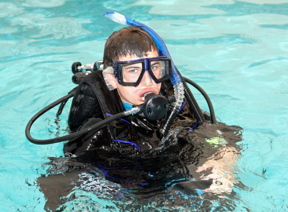 Young man in scuba attire